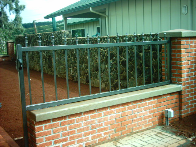 Galvanized steel fence with ornamental finials